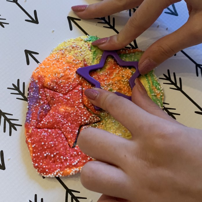 cut putty with plastic shapes