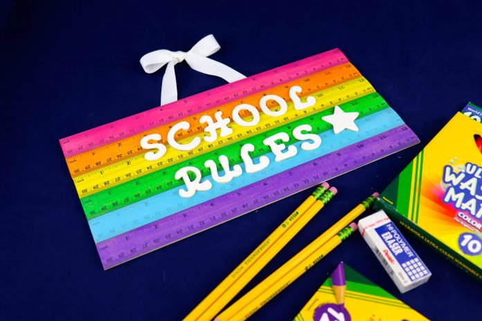 make a school rules sign