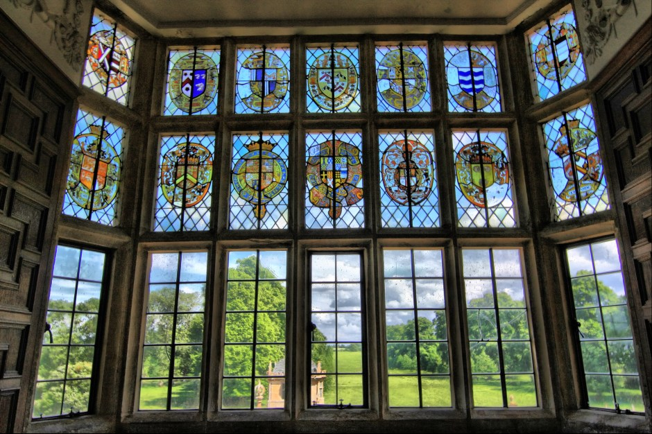 Stained_glass_window_overlooking_gardens_of_Montacute_House_4675709559