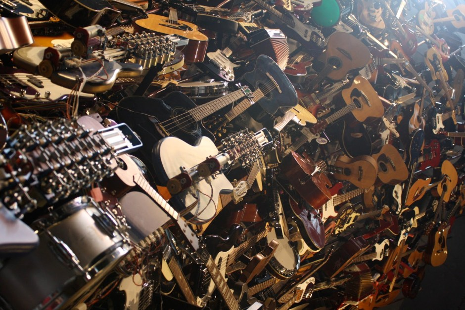 huge-pile-of-guitars