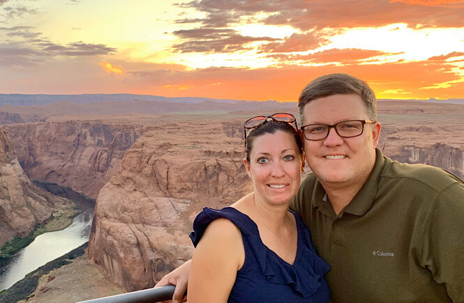 The Best 2 Things To Do in Page Arizona as featured by top US family travel blog, More than Main Street; Couple at Horseshoe Bend in Page Arizona.
