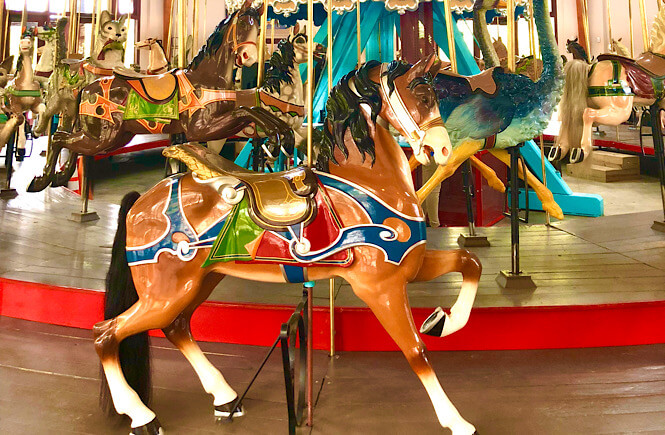 Top 10 Fun Things to Do in Raleigh with Kids tips featured by top North Carolina travel blog More than Main Street: Carousel at Pullen Park.
