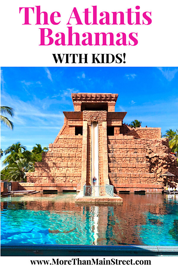 Bahamas Family Vacation: Top 10 Tips for Visiting Atlantis with Kids as featured by top US family travel blog More than Main Street: waterslide.