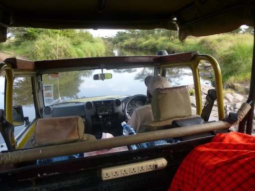 Driver maneuvering across a riverbed on the way to a bush dinner in the Motorogi Conservancy in Kenya