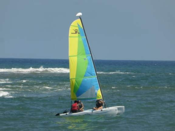 Guests sail a catamaran at Secrets Huatulco