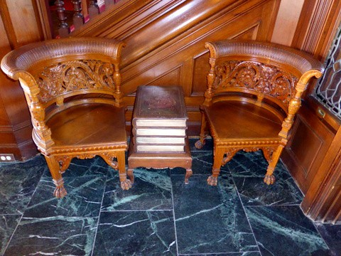 Intricately-carved chairs at the entrance lobby