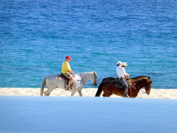 Horseback riders on the beach