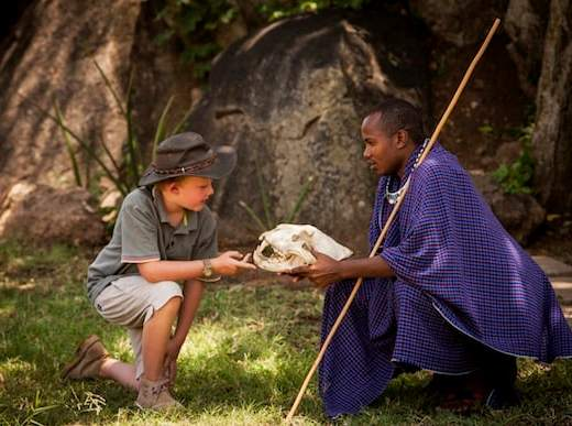 Young visitor with Masai tribesman (Credit: Four Seasons Hotels and Resorts)