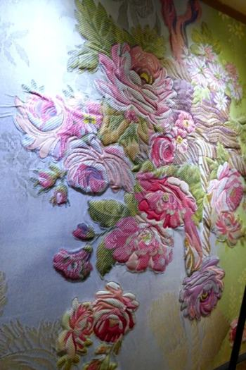Part of the silk fresco in the lobby