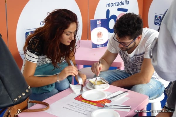 Two mortadella lovers enjoy the dish they have cooked