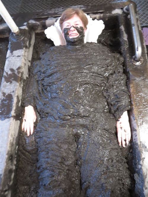 Sandra in the volcanic mud bath (Credit: John Nowlan)