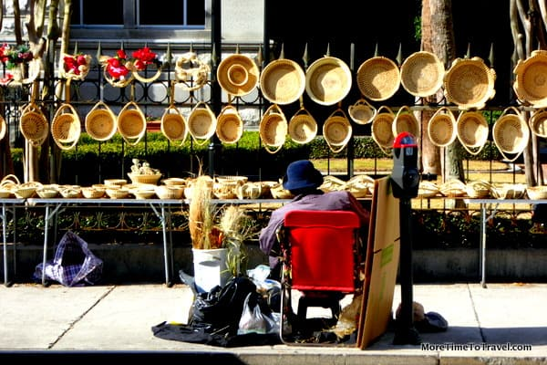 Woman selling sweetgrass baskets in front of the Post Office and Courthouse on Meeting Street, part of the 4 Corners of Law