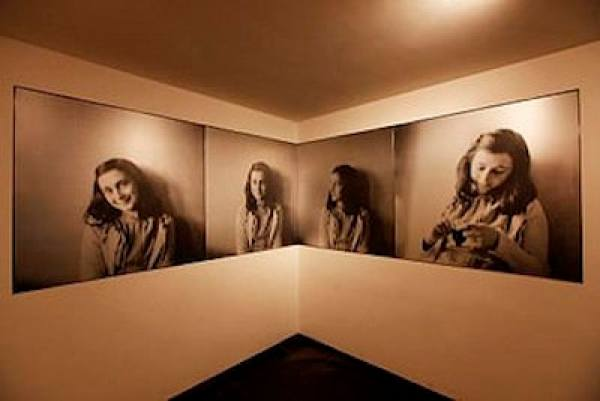 Photos of Anne Frank on display just beyond the entrance (Credit: Anne Frank House)