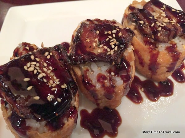 Foie Gras Inari Sushi, a piece of perfectly seared foie gras on top of a fried rice roll