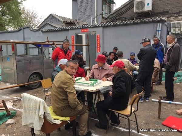 Local hutong residents playing mah jongg