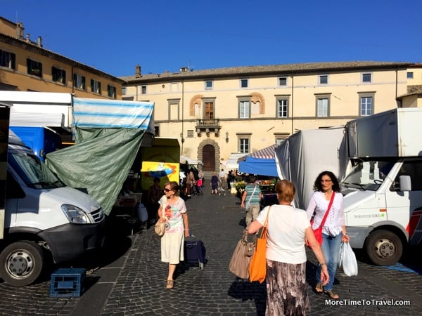 Early morning shoppers begin arriving at the market in Orvieto