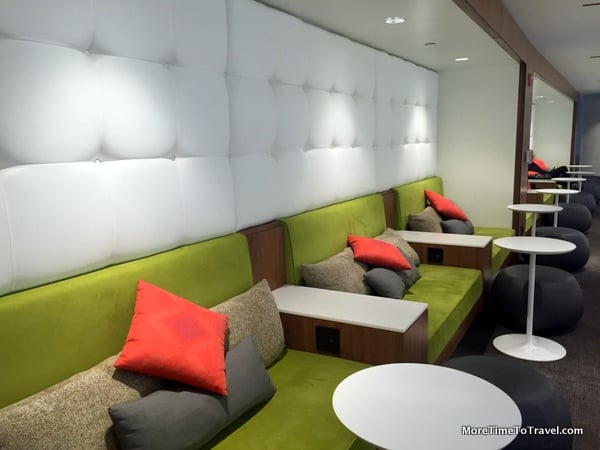 Comfortable lounge area with flat screen TVs on the opposite wall