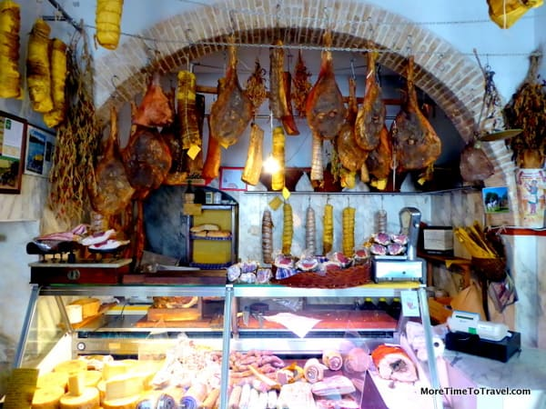 Salumi (cured meats) on display at the butcher shop in Bevagna