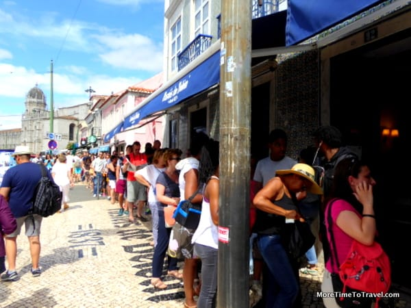 Line outside the bakery extending towards the monastery