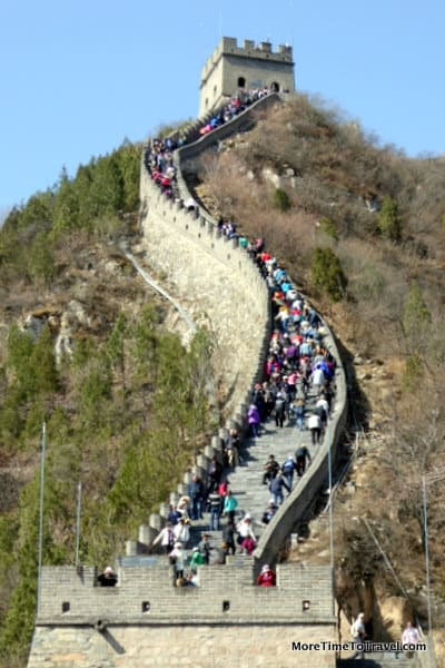Tourists ascending steps on the Great Wall at Juyong Pass