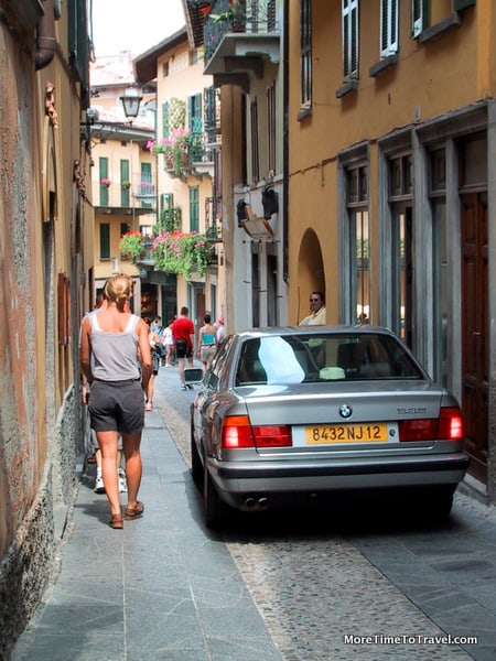 Narrow shopping street in Bellagio shared by pedestrians, bicyclists and cars