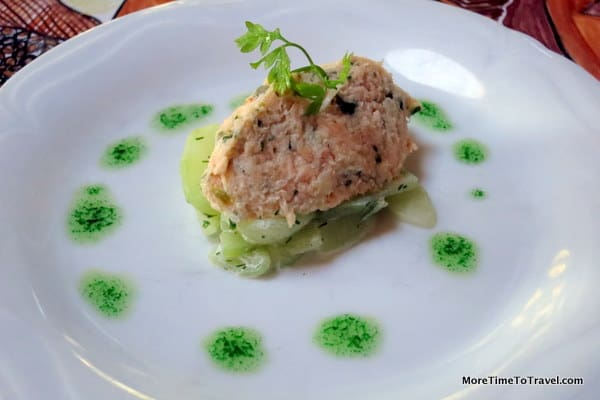 Amuse bouch of chopped salmon and halibut over cucumber mousse