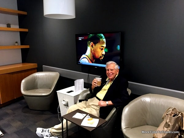 Relaxing in the glass-enclosed TV room at the Airspace Lounge at JFK