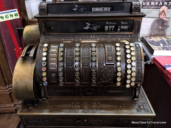 Old cash register at the rear of the shop