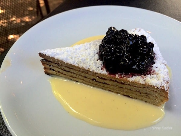 Decadent Baumkuchen, a German layer cake with huckleberry compote and creme anglaise