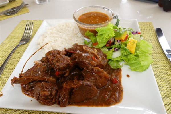 Traditional goat stew, rice and beans