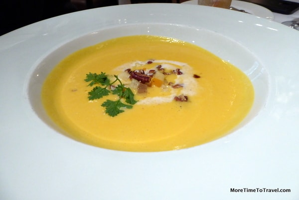 Squash soup with Honeycrisp apples, toasted pecans and cinnamon-spiced marscarpone