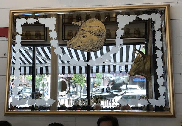 View of Amsterdam Avenue through a mirror at White Gold Butchers