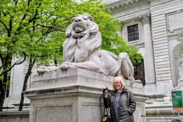 Patience and Fortitude are the two world-renowned marble lions outside the New York Public Library (the author next to one of them)