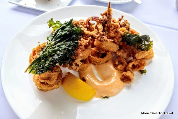 Crispy calamari with baked kale chips and lemon crema