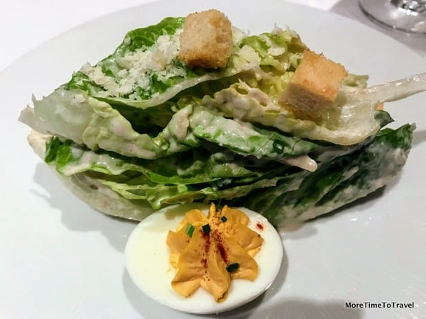 Gotham caesar salad with white anchovy, parmesan, deviled egg, and garlic croutons