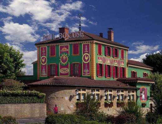 The colorful and less than subtle facade of the Paul Bocuse Restaurant