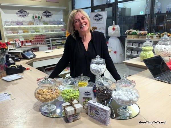 Friendly vendor explains the history of Di Carlo confetti candies at FICO