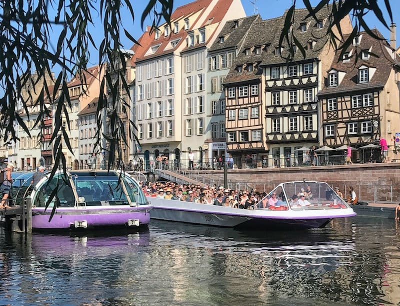 One Day in Strasbourg Covered and open tour boats on the River Ill