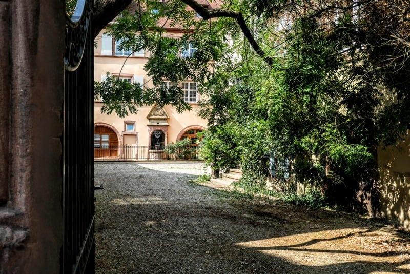 The best day trip from Strasbourg - A welcoming courtyard in Kayserberg
