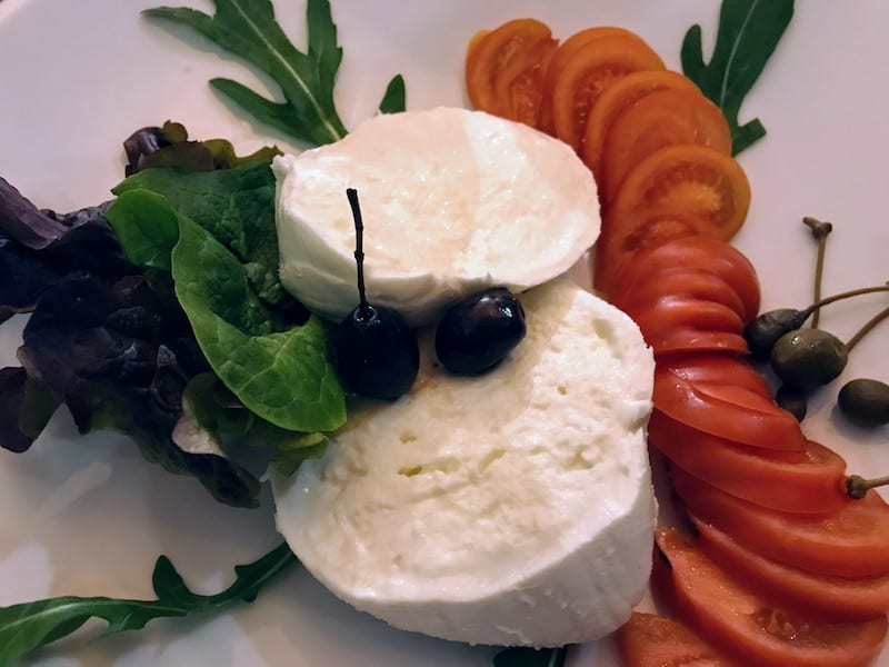 Salad plate with burrata and tomatoes