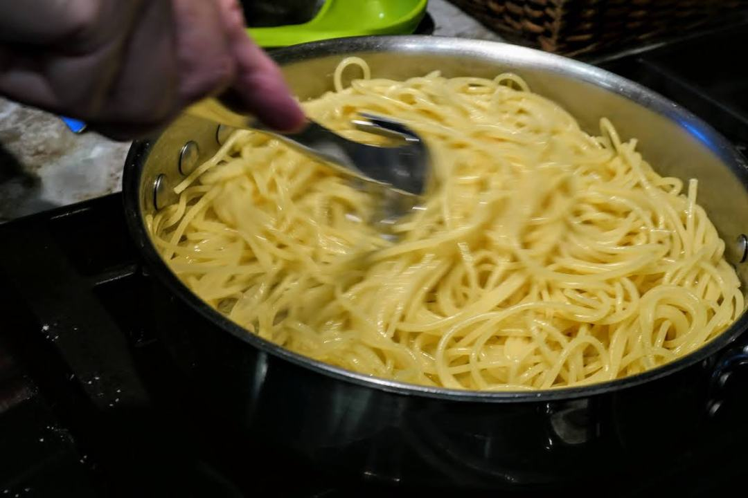 Stirring the egg mixture quickly into the pasta on my stove