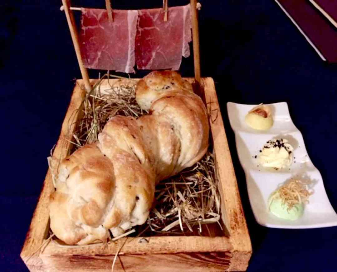 Special bread and butter each evening: Truffle ciabatta twist with clothesline speck