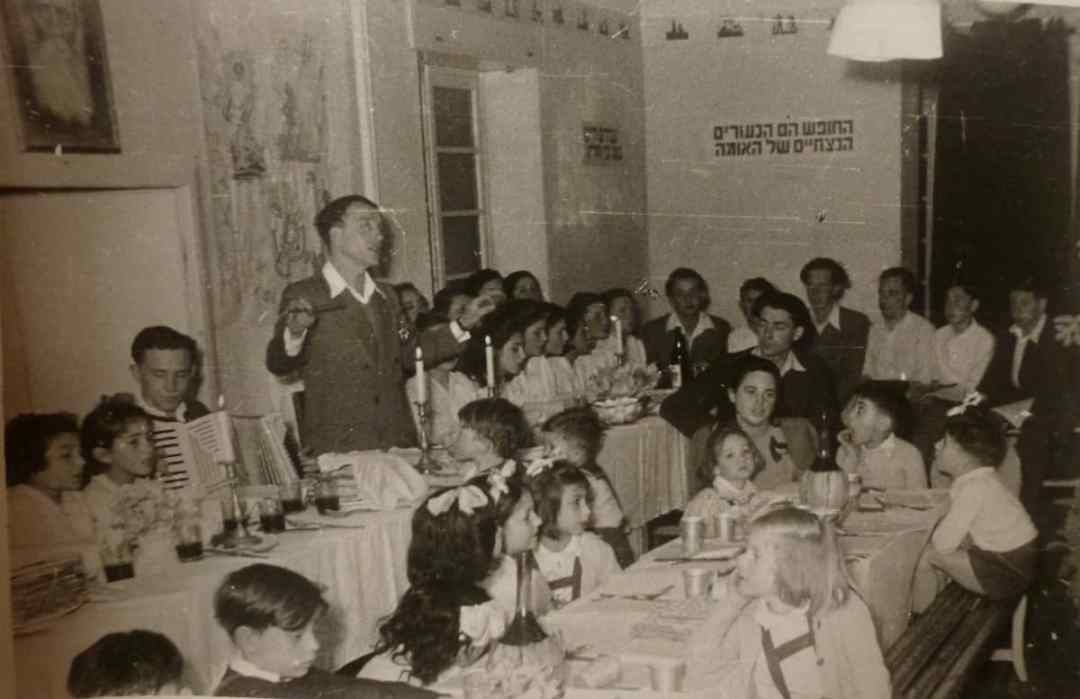 Vintage photo of Passover Eve at the Sciesopoli House (credit: Wikipedia Commons)