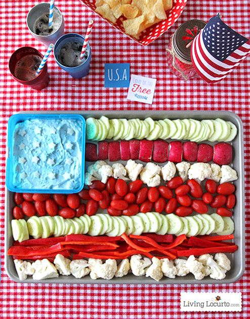 an american flag vegetable tray patriotic snack on a gingham tablecloth