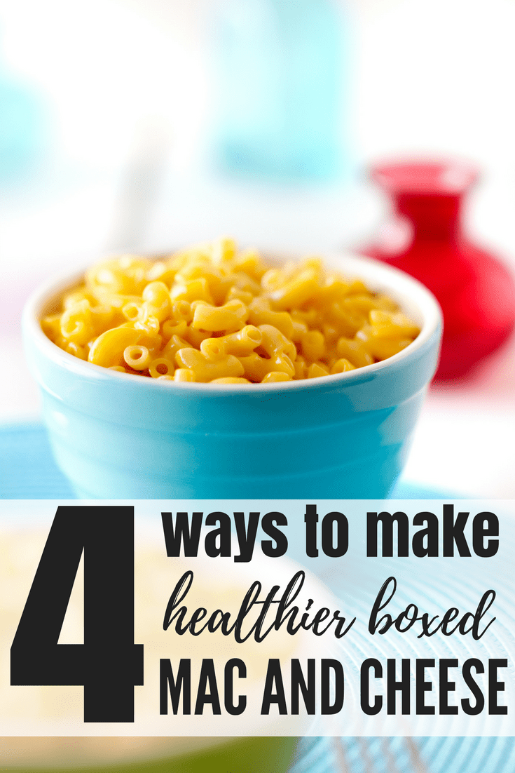 """healthy boxed Mac and cheese in a blue bowl with a muted background with the words """"4 ways to make healthier boxed mac and cheese"""" overlayed"""