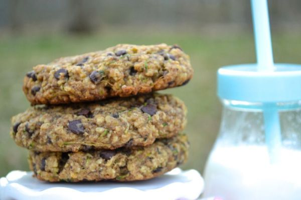 zucchini breakfast cookies stacked with a strawed bottle full of milk in the background
