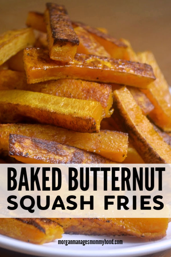 a stack of crispy, sweet, orange butternut squash fries on a white plate with a brown wood background