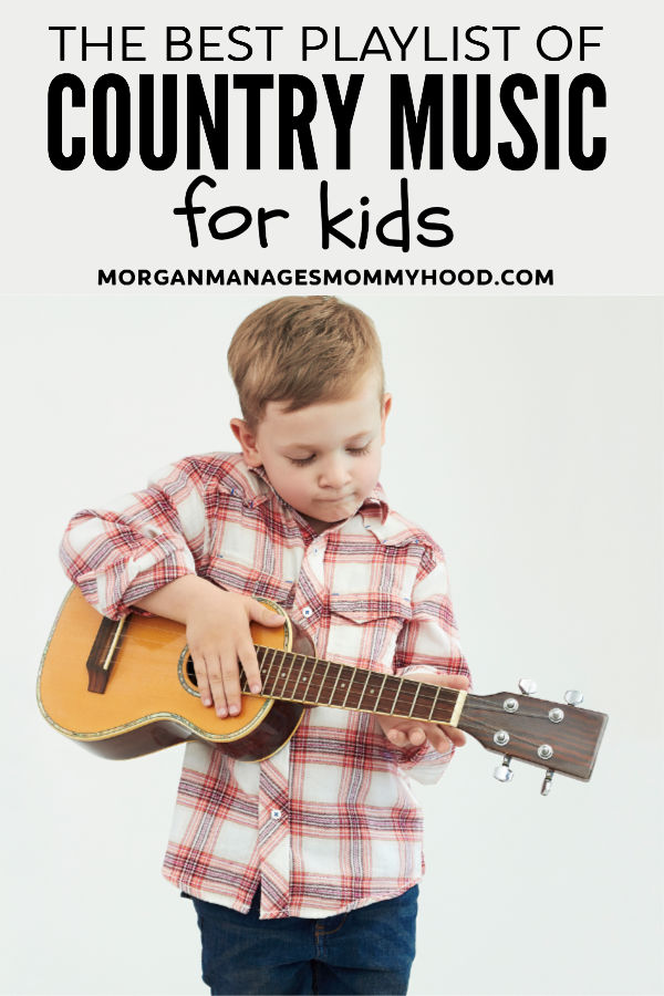 a little boy in a red plaid shirt playing a small acoustic guitar
