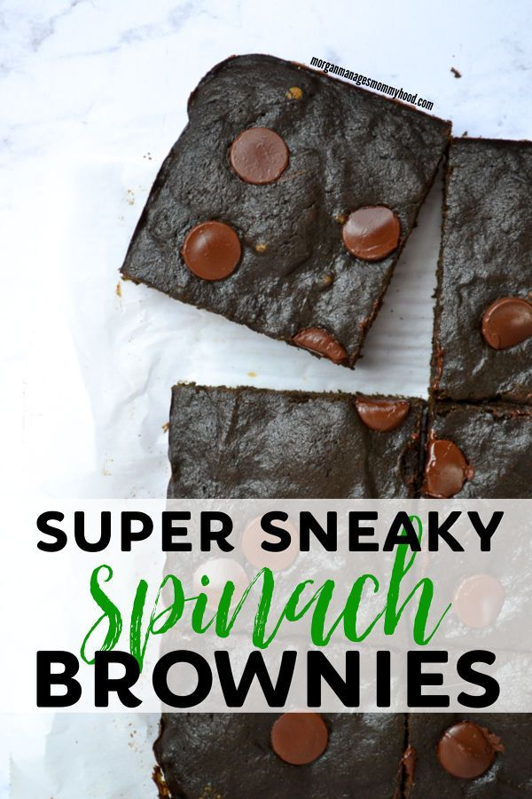 a pinable image showing spinach brownies on parchment and marble