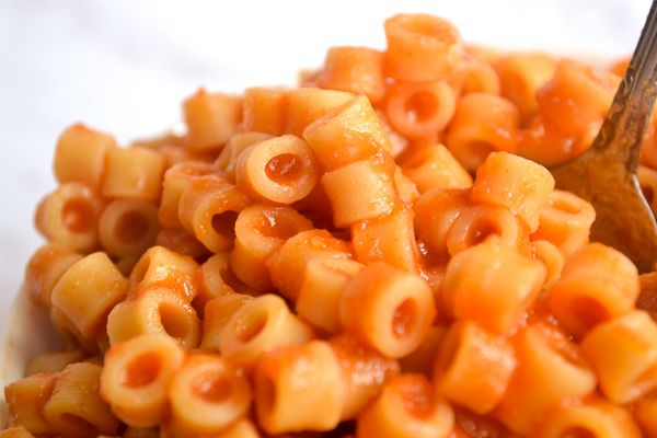 a close up of ditalini pasta covered in homemade spaghettio sauce